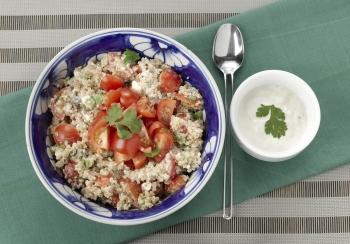 Quinoa met tomaatjes & feta dressing